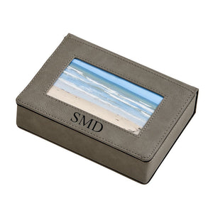 Grey leatherette keepsake box with photo insert on the lid and monogrammed beneath the photo. Engraving is black.