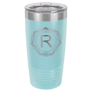 Light blue engraved tumbler with a skinny ribbed bottom to fit in a cup holder. Comes with a clear plastic lid.