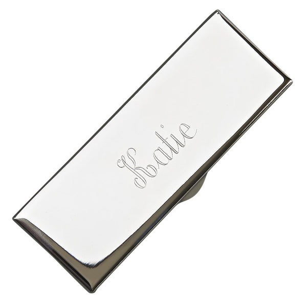 Shiny silver engraved lipstick holder. The top is engraved with a a name in a beautiful cursive font. Inside is lined with black felt.