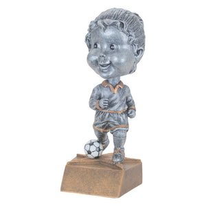 Kid's female soccer trophy featuring a bobble head and a little girl dribbling a soccer ball.