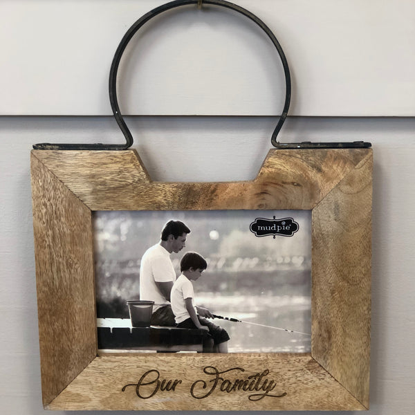 "Wooden picture frame with round metal hanger at the top for wall display. Frame is engraved to read ""Our Family"" in a beautiful cursive font."