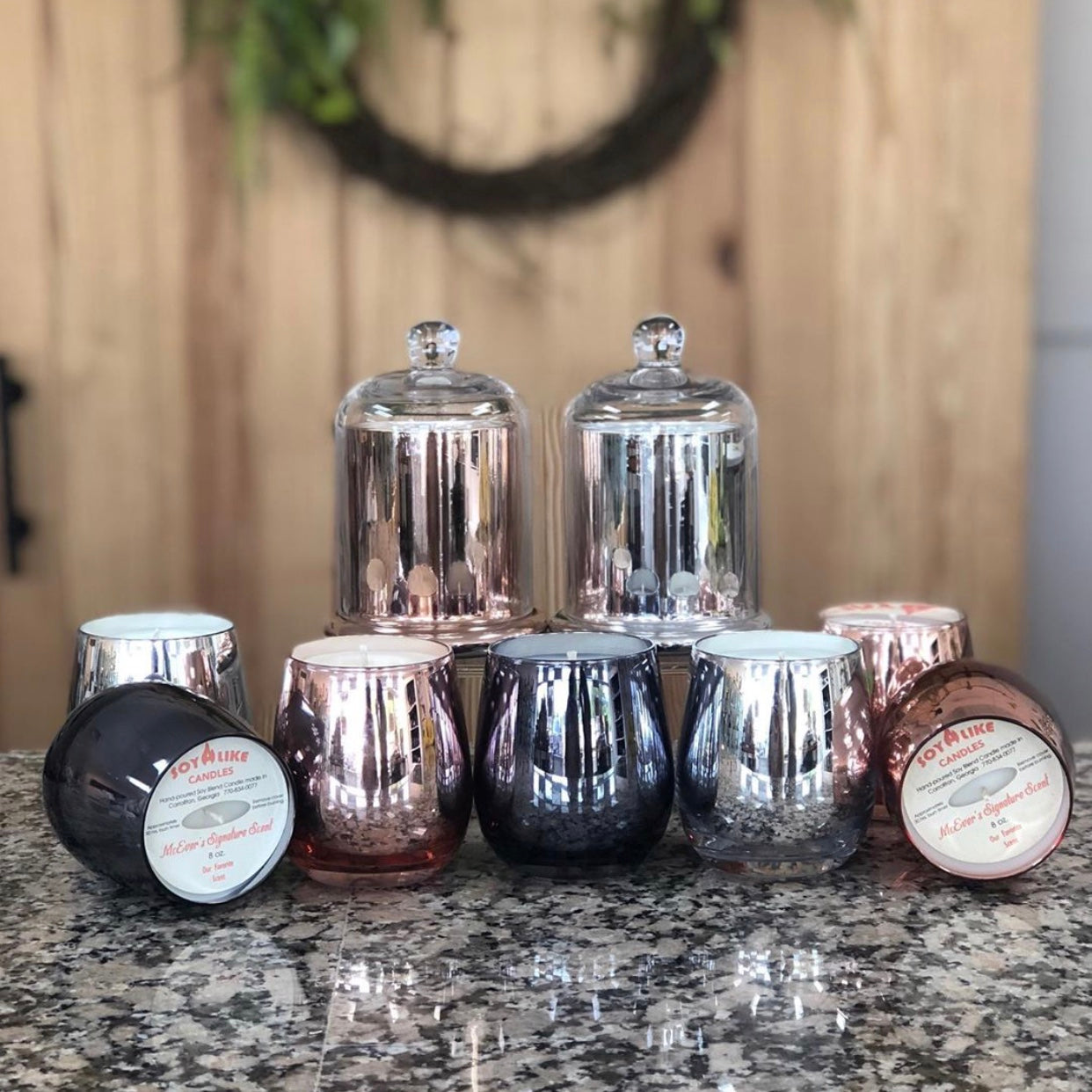 Hand poured white wax candles in metallic rose gold, silver, or black wine glass shaped containers.