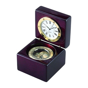 High gloss rosewood hinged box featuring a compass in the bottom half and a clock on  the top half when opened. The clock and compass are outlined in gold. The clock has a white face with black hands and roman numerals.