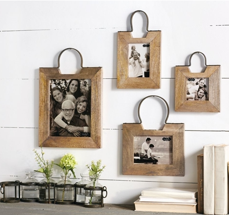 Wooden picture frame with round metal hanger at the top for wall display.