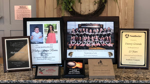 All sizes and colors of engraved plaques, picture plaques, and awards.