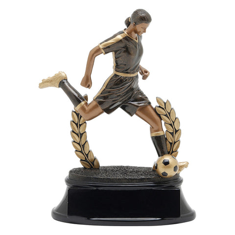 Black and gold soccer trophy featuring a black oval shaped base, a wreath, and a female soccer player with her leg extended as if she is about to kick a soccer ball.