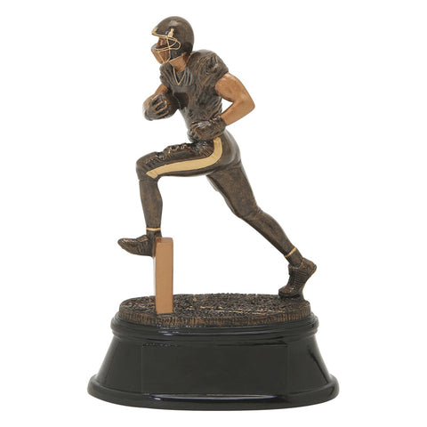 Black and bronze football trophy featuring a black oval base and a football player running with his leg up and football tucked in one arm.