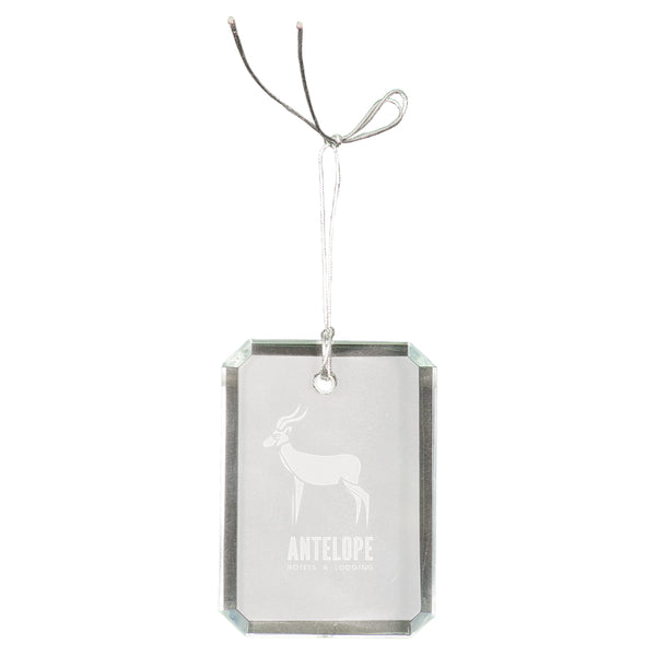 Rectangle shaped crystal ornament that is faceted on the sides and is engraved with an antelope in the center in a frosty white color. A silver string is attached at the top for hanging.