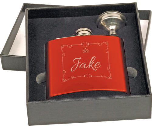 Shiny red flask with shiny silver top and small funnel. Flask is engraved with a name and square design in silver. Flask and funnel are displayed in a rectangle display box in foam.