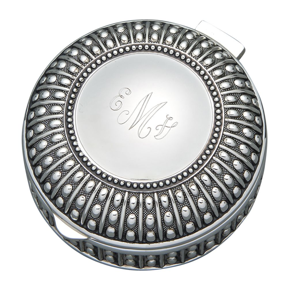 Round jewelry box with hinged lid and a beaded design. The top features a silver circle with a flat area for engraving. The top is engraved with a monogram in a cursive font.