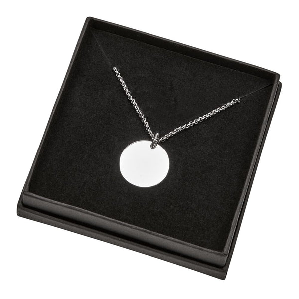 Engraved silver disc pendant necklace.