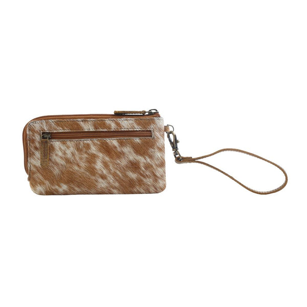 white and brown cowhide wallet
