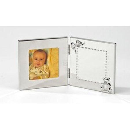 Shiny silver hinged baby frame that opens up to reveal a photo frame on the left side, and a square engraving space on the right side. The engraving space is outlined in small dots, a bow in the upper left corner, and a teddy bear in the bottom right corner