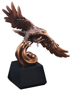 Bronze eagle award featuring a black square base an a bronze soaring eagle with its wings spread wide and talons out.
