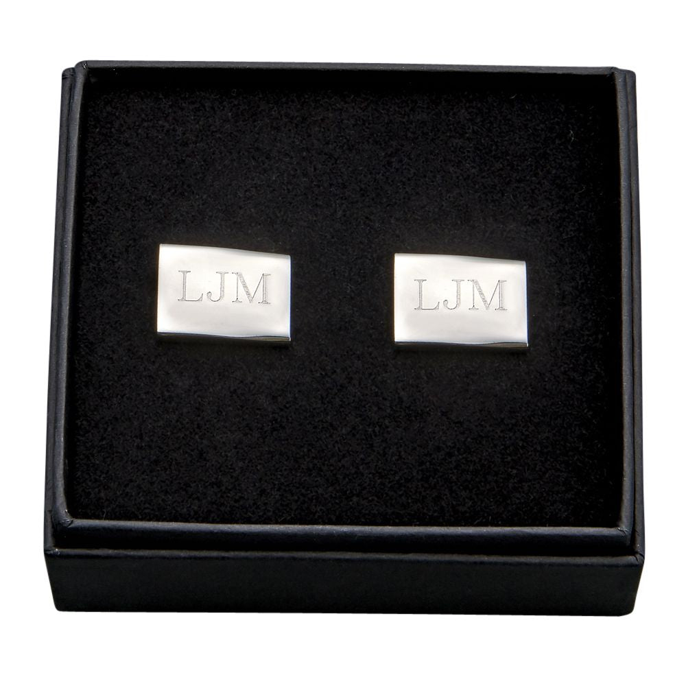 Rectangle shaped silver stainless steel cuff links engraved with a monogram.