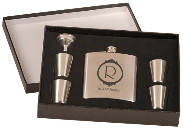 Stainless steel personalized flask set includes four shot glasses and a funnel.