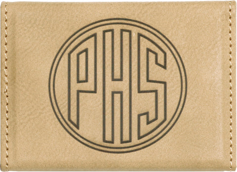 Tan leatherette business card holder engraved with a monogram on the back.