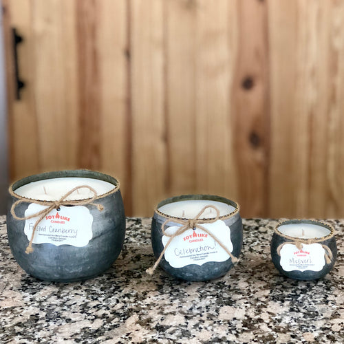 Large, medium or small hand poured white wax candles in silver galvanized round tin containers with gold beaded edges