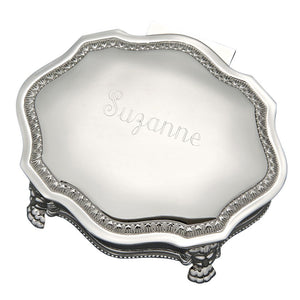 Victorian style octagon shaped jewelry box with feet. Features an ornate design on the sides and border of the top. The lid is is flat shiny silver and is engraved with a name in a beautiful cursive font.