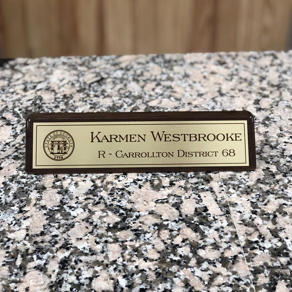 Personalized walnut desk name plate with name and title.