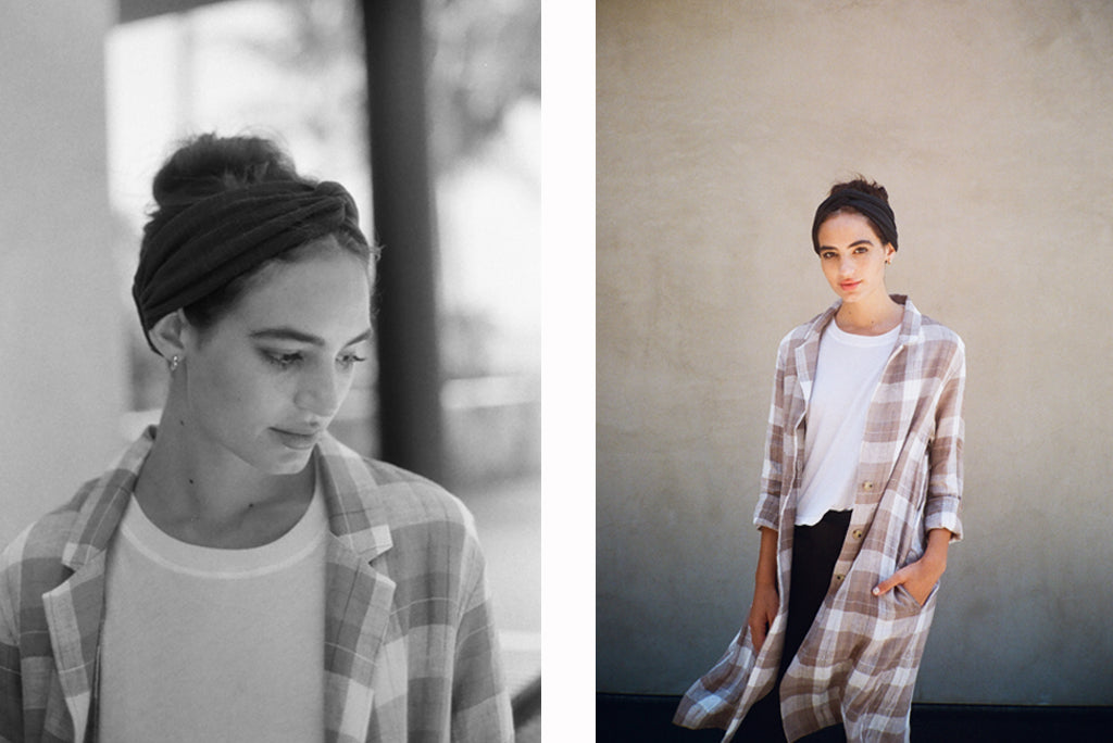 Model wearing the lady & the sailor Midi Blazer in tawny plaid.