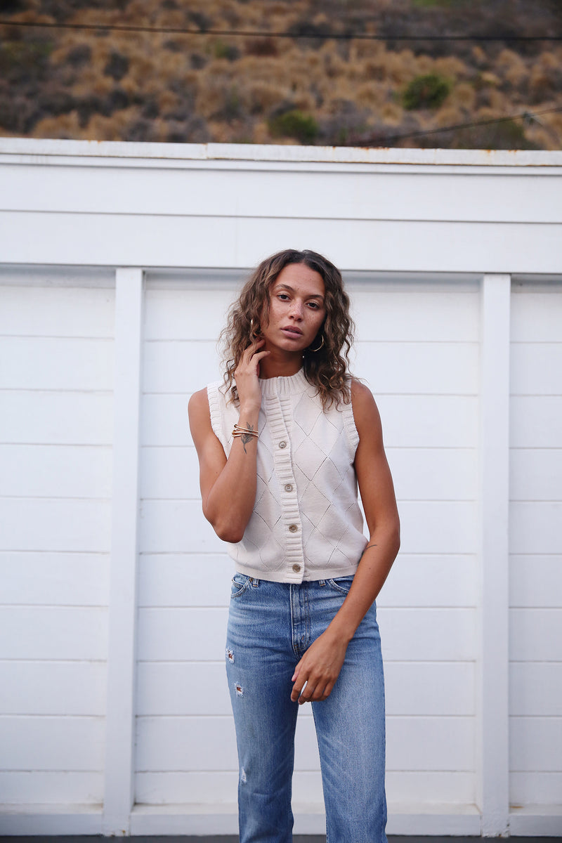 Model wearing the lady & the sailor Allude Vest in Stone White.