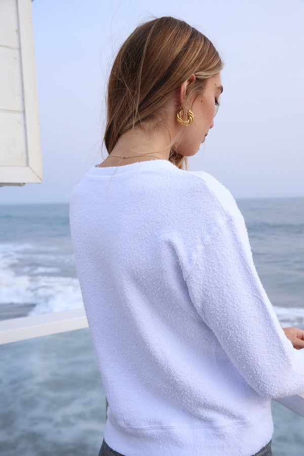 Model wearing the lady & the sailor Varsity Sweatshirt in White Boucle.