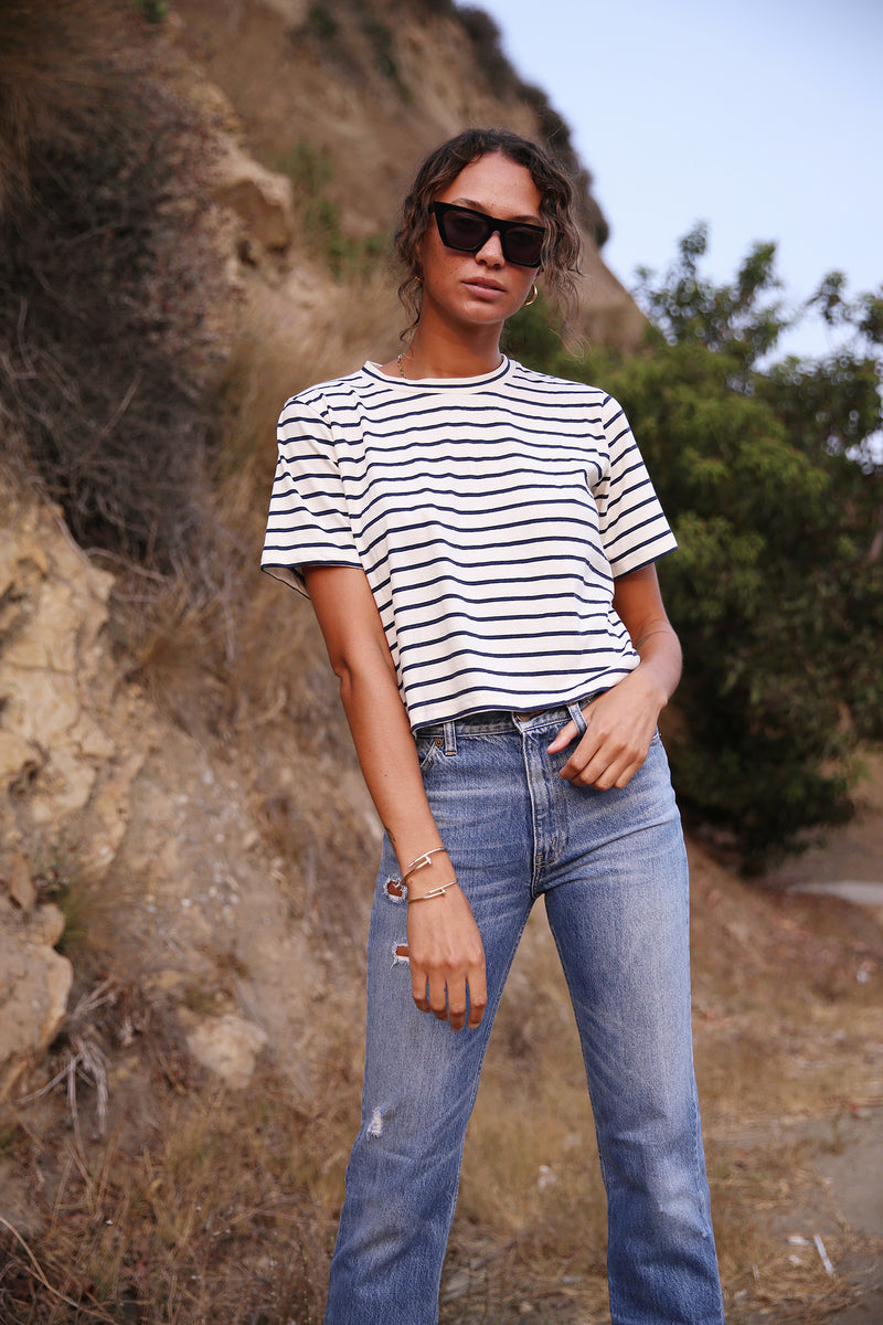 Model wearing the lady & the sailor Vintage Tee in Navy and Ivory Stripe.