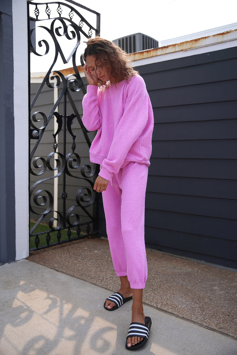 Model wearing the lady & the sailor Vintage Sweatpant in Bubblegum Boucle.