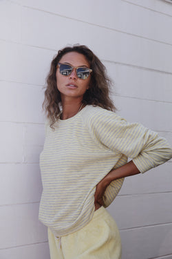 Model wearing the lady & the sailor Brentwood Sweatshirt in Citrus Yellow Stripe.