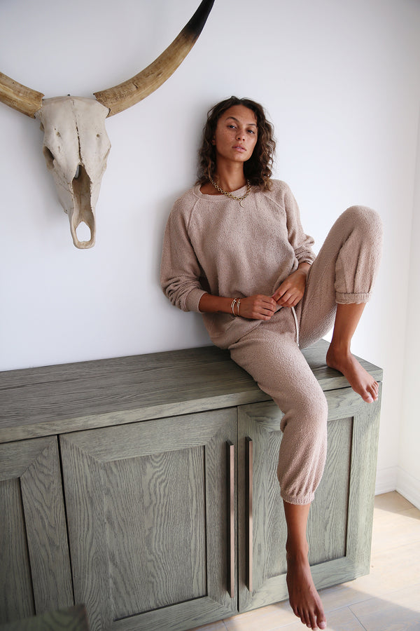 Model wearing the lady & the sailor Vintage Sweatpant in Sand Boucle.