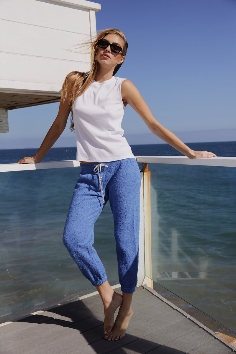Model wearing the lady & the sailor Vintage Sweatpant in Bahama Blue Boucle.