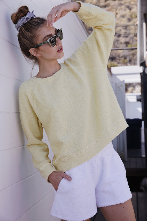 Model wearing the lady & the sailor Brentwood Sweatshirt in Citrus Boucle.
