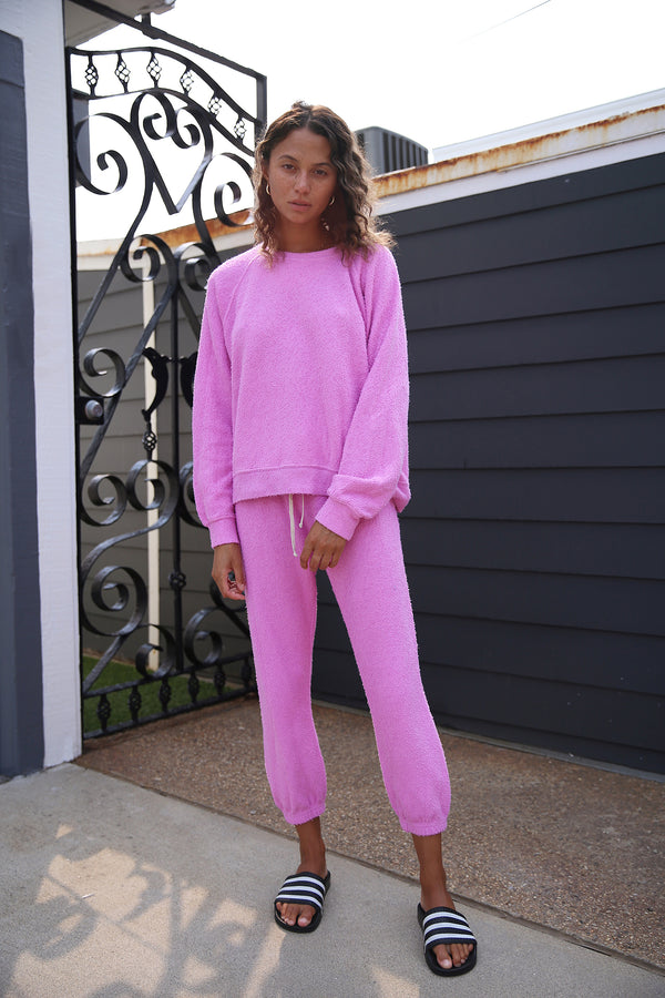 Model wearing the lady & the sailor Brentwood Sweatshirt in Bubblegum Boucle.