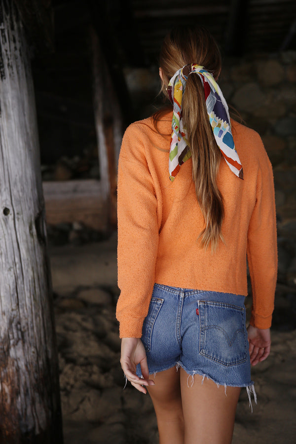 Model wearing the lady & the sailor Vintage Sweatshirt in Tangerine Boucle.