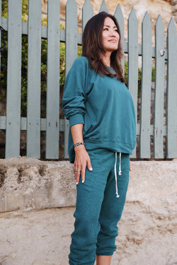 Model wearing the lady & the sailor Brentwood Sweatshirt in Emerald Bay Green Organic Cotton.
