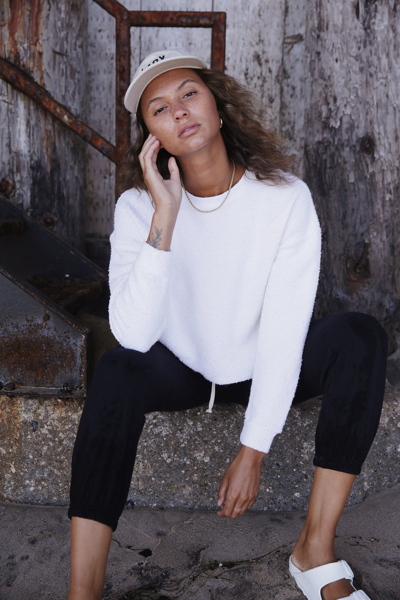 Model wearing the lady & the sailor Vintage Sweatshirt in Vanilla Boucle.