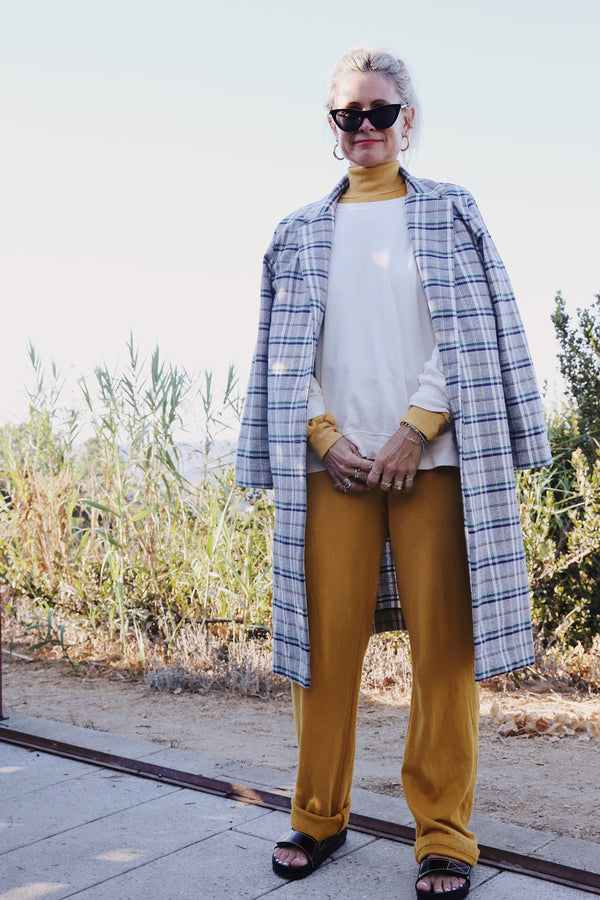 Model wearing the lady & the sailor the Heather Pant in Golden Hour Organic Cotton.