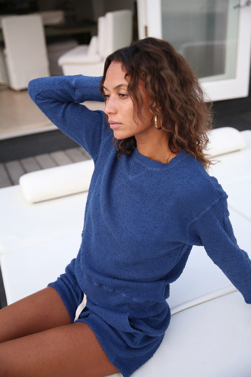 Model wearing the lady & the sailor Varsity Crewneck in Royal Boucle.