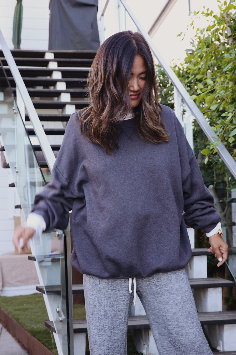 Model wearing the lady & the sailor the Sandi Sweatshirt in Slate Fleece.