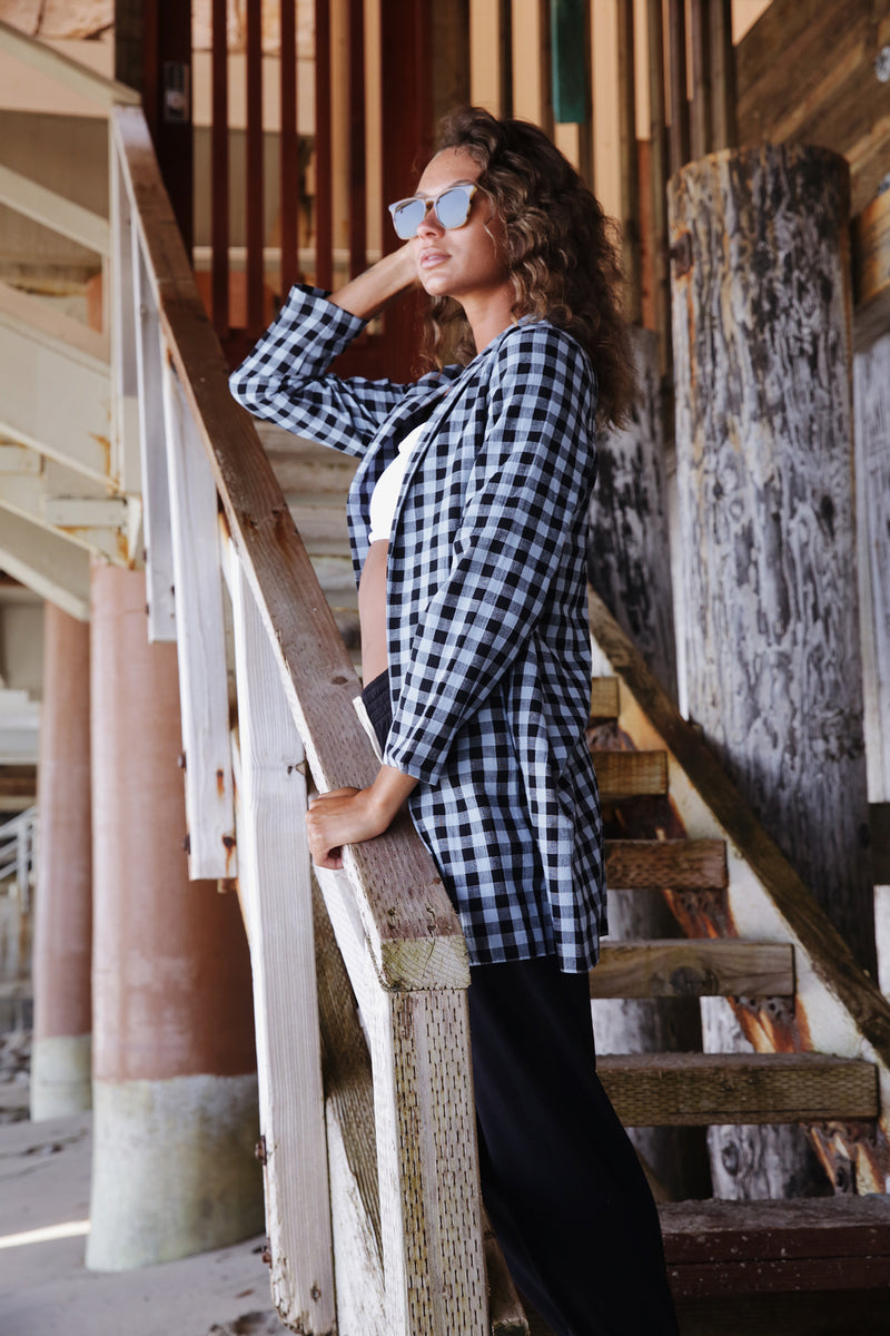 Model wearing the lady & the sailor Painter's Jacket in Blue Gingham.