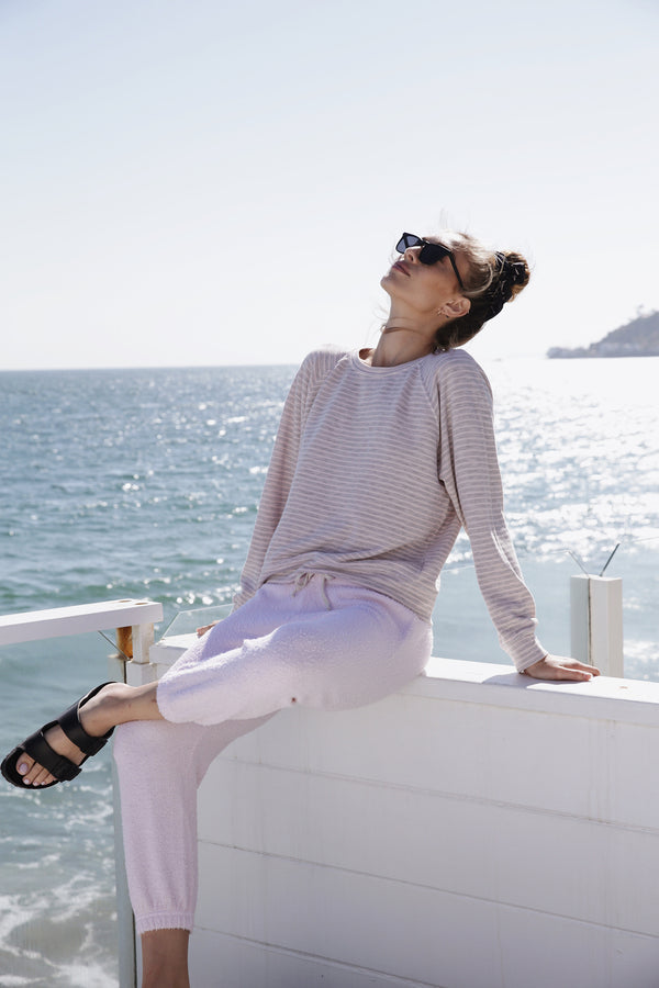 Model wearing the lady & the sailor Brentwood Sweatshirt in Baby Pink Stripe.