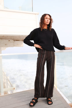 Model wearing the lady & the sailor Relaxed Pant in black stripe.