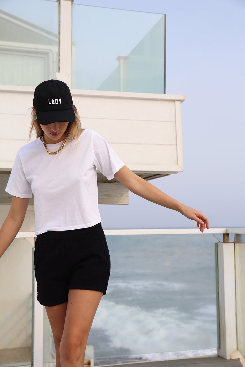 Model wearing the lady & the sailor Vintage Tee in White Luxe Cotton.