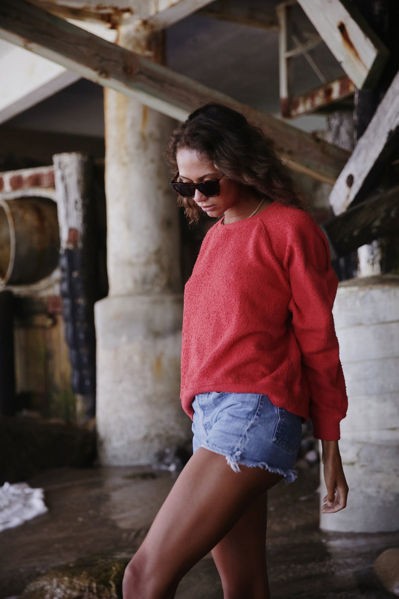 Model wearing the lady & the sailor Brentwood Sweatshirt in Poppy Boucle.