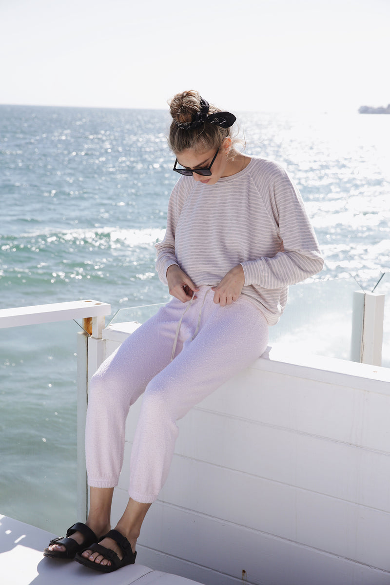 Model wearing the lady & the sailor Vintage Sweatpant in Baby Pink Boucle.