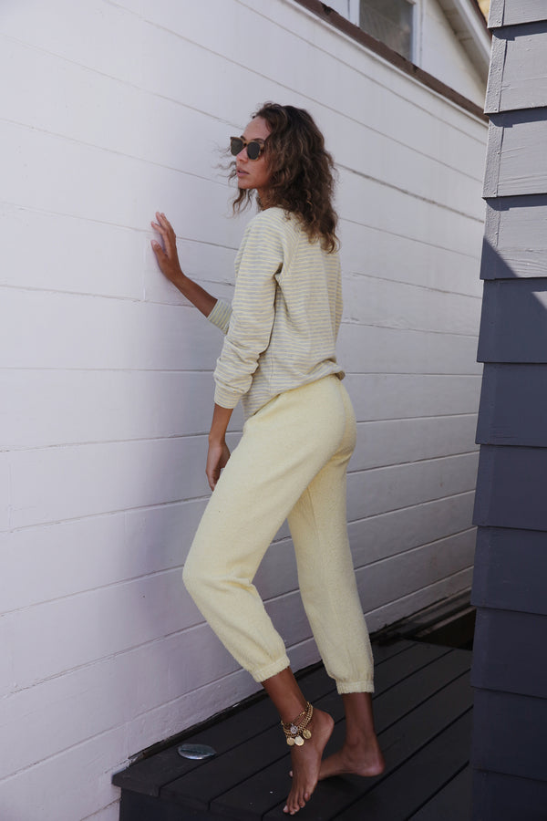 Model wearing the lady & the sailor Vintage Sweatpant in Citrus Yellow Boucle..