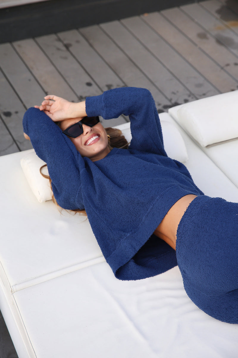 Model wearing the lady & the sailor Brentwood Sweatshirt in Royal Boucle.