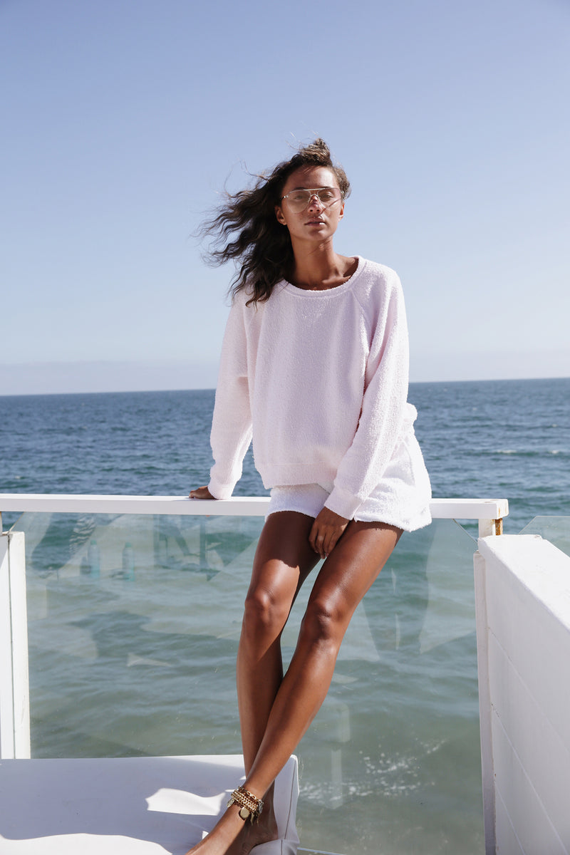 Model wearing the lady & the sailor Brentwood Sweatshirt in Baby Pink Boucle.