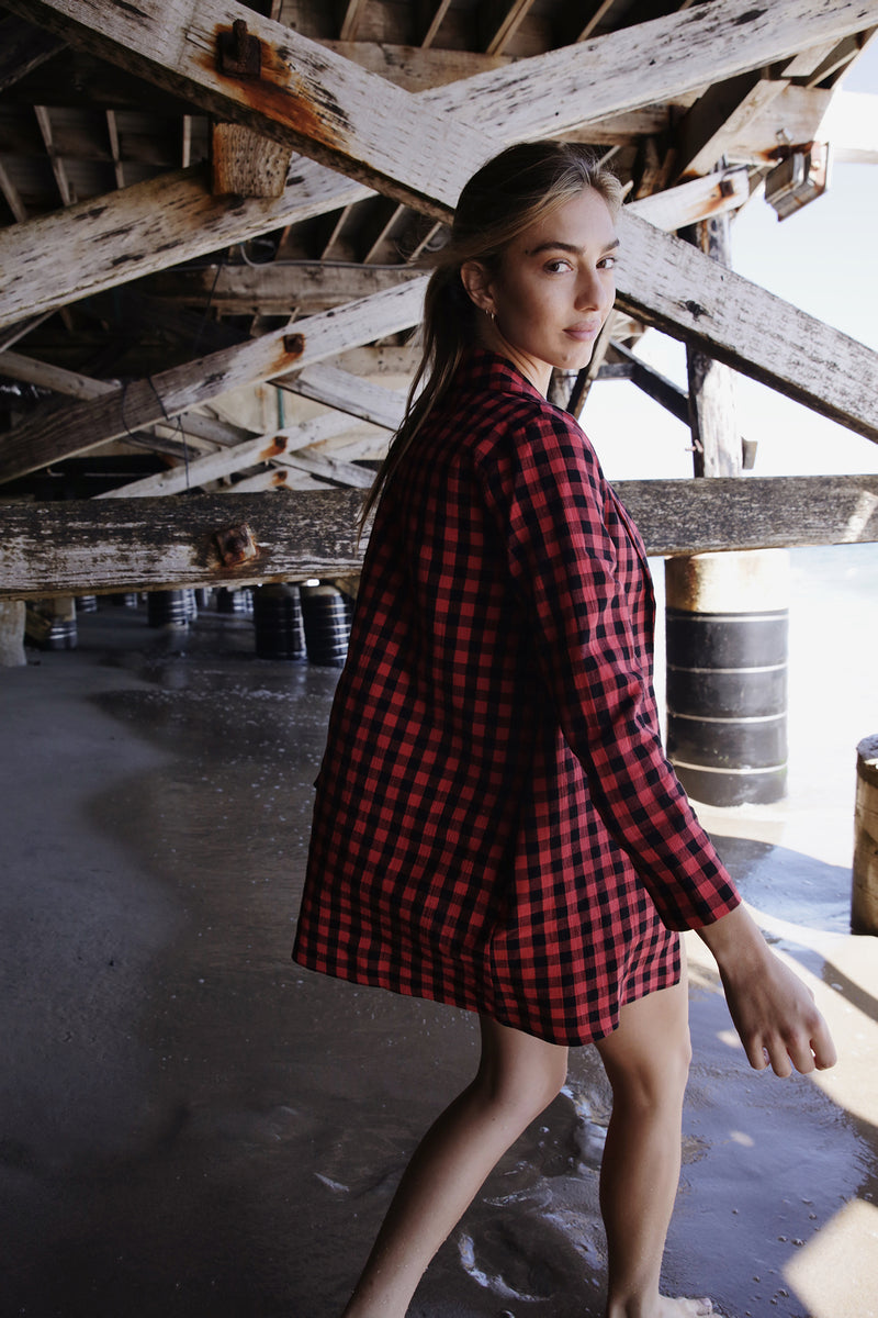 Model wearing the lady & the sailor Painter's Jacket in Poppy Gingham.